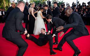 How to Train Your Dragon 2' Red Carpet at The Palais des Festivals during the 67th Cannes Film FestivalUkranian journalist, Vitalii Sediuk runs onto the red carpet and dives under America Ferrera's dress while the cast pose on the carpet, causing security to drag him off the carpet by his ankles on May 16, 2014. Picture: Joanne Davidson/The Picture Library