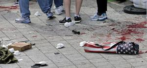 Blood from victims covers the sidewalk on Boylston Street, at the site of an explosion during the 2013 Boston Marathon in Boston, Monday, April 15, 2013. At the right foreground is a folding chair with the design of an American flag on the cover.  Two explosions shattered the euphoria of the Boston Marathon finish line on Monday, sending authorities out on the course to carry off the injured while the stragglers were rerouted away from the smoking site of the blasts. (AP Photo/Charles Krupa)
