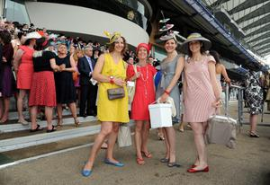 ASCOT, UNITED KINGDOM - JUNE 20: Race goers attend Ladies Day on Day 3 of Royal Ascot at Ascot Racecourse on June 20, 2013 in Ascot, England. (Photo by Eamonn M. McCormack/Getty Images)
