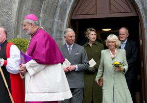 The Prince of Wales and the Duchess of Cornwall (centre) and Former President of Ireland Mary McAleese and her husband Martin (behind) after a peace and reconciliation prayer service at St. Columba's Church in Drumcliffe on day two of a four day visit to Ireland. PRESS ASSOCIATION Photo. Picture date: Wednesday May 20, 2015. See PA story ROYAL Ireland. Photo credit should read: Colm Mahady/PA Wire