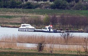 The boat involved in the tragedy moored at the rear of Devenish Island along with a police boat.