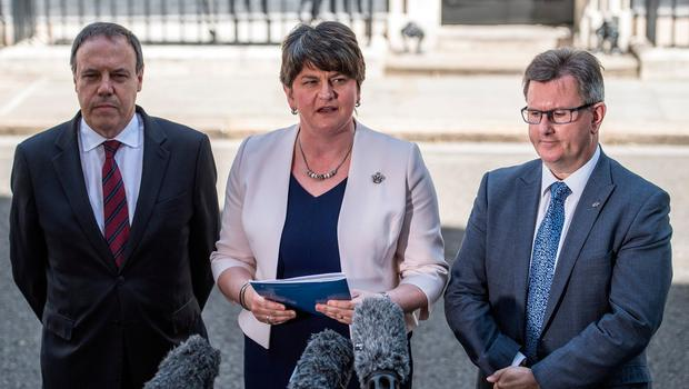 Arlene Foster, the leader of Northern Ireland's Democratic Unionist Party, party deputy leader, Nigel Dodds and MP Jeffrey Donaldson (R), speak to the media as they leave after meeting Prime Minister Theresa May in 10, Downing Street on June 26, 2017 in London.