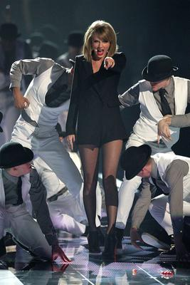 Taylor Swift performs on stage during the 2015 Brit Awards at the O2 Arena, London.