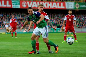 Northern Ireland's Conor Washington (left) and Belarus' Nikita Korzun battle for the ball during the International Friendly at Windsor Park, Belfast. PRESS ASSOCIATION Photo. Picture date: Friday May 27, 2016. See PA story SOCCER N Ireland. Photo credit should read: Niall Carson/PA Wire. RESTRICTIONS: Editorial use only, No commercial use without prior permission, please contact PA Images for further information: Tel: +44 (0) 115 8447447.