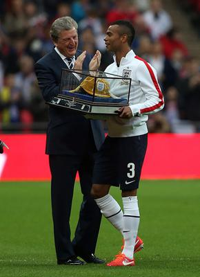 England's captain Ashley Cole is applauded by his manager Roy Hodgson after receiving his 100th cap during the International Friendly match at Wembley Stadium, London. PRESS ASSOCIATION Photo. Picture date: Wednesday May 29, 2013. See PA story SOCCER England. Photo credit should read: John Walton/PA Wire. RESTRICTIONS: Use subject to FA restrictions. Editorial use only. Commercial use only with prior written consent of the FA. No editing except cropping. Call +44 (0)1158 447447 or see www.paphotos.com/info/ for full restrictions and further information.