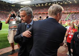 Manchester United manager David Moyes (right) embraces Chelsea manager Jose Mourinho prior to kick-off during the Barclays Premier League match at Old Trafford, Manchester. PRESS ASSOCIATION Photo. Picture date: Monday August 26, 2013. See PA story SOCCER Man Utd. Photo credit should read: Martin Rickett/PA Wire. RESTRICTIONS: Editorial use only. Maximum 45 images during a match. No video emulation or promotion as 'live'. No use in games, competitions, merchandise, betting or single club/player services. No use with unofficial audio, video, data, fixtures or club/league logos.