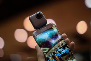 A Wink PTU 360-degree spherical camera is shown with an Android phone during the 2017 Consumer Electronics Show (CES) in Las Vegas, Nevada on January 3, 2017.   / AFP PHOTO / DAVID MCNEWDAVID MCNEW/AFP/Getty Images