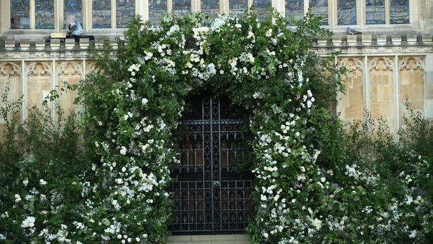 Floral arch: Flowers and foliage surround the West Door of St George's Chapel (Danny Lawson/PA)
