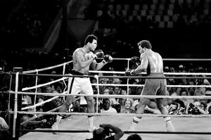 This file photo taken on October 30, 1974 shows Former world heavyweight champion Muhammad Ali (L) and titleholder US George Foreman (R) fighting on October 30, 1974 in Kinshasa, Zaire during their world heavyweight championship match. Ali won by knocking out Foreman in the eighth round. Heavyweight boxing legend Muhammad Ali, an icon of the 20th Century whose fame transcended the sport during a remarkable career that spanned three decades, died June 3, 2016, his family said. / AFP PHOTO / --/AFP/Getty Images