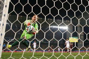 Igor Akinfeev of Russia fails to save a shot by Lee Keun-Ho of South Korea for South Korea's first goal during the 2014 FIFA World Cup Brazil Group H match between Russia and South Korea at Arena Pantanal on June 17, 2014 in Cuiaba, Brazil.  (Photo by Warren Little/Getty Images)