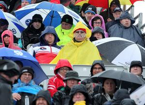 @Press Eye Ltd Northern Ireland- 15th   May   2014 Mandatory Credit -Brian Little/Presseye  Motorcycle fans shelter  from the showers under umbrella's at the Vauxhall International 2014  North West 200.  Picture by  Brian Little/Presseye