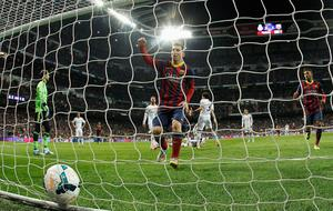 Lionel Messi of Barcelona celebrates scoring his goal during the La Liga match between Real Madrid CF and FC Barcelona at the Bernabeu on March 23, 2014 in Madrid, Spain.  (Photo by Gonzalo Arroyo Moreno/Getty Images)