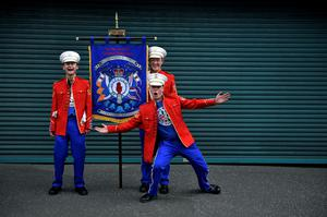 BELFAST, NORTHERN IRELAND - JULY 12: Orange band members pose before taking part in the annual Twelfth of July Orange demonstration march on July 12, 2019 in Belfast, Northern Ireland. The Twelfth is an annual Ulster Protestant celebration of the victory of the Protestant King William of Orange over the Catholic forces of King James at the Battle of the Boyne in 1690. (Photo by Charles McQuillan/Getty Images)