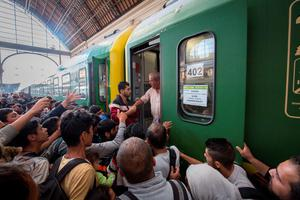 BUDAPEST, HUNGARY - SEPTEMBER 03:  Migrants board a train in Keleti station after it was reopened this morning in central Budapest on September 3, 2015 in Budapest, Hungary. Although the station has reopened all international trains to Western Europe have bee cancelled. According to the Hungarian authorities a record number of migrants from many parts of the Middle East, Africa and Asia are crossing the border from Serbia. Since the beginning of 2015 the number of migrants using the so-called Balkans route has exploded with migrants arriving in Greece from Turkey and then travelling on through Macedonia and Serbia before entering the EU via Hungary. The massive increase, said to be the largest migration of people since World War II, led Hungarian Prime Minister Victor Orban to order Hungary's army to build a steel and barbed wire security barrier along its entire border with Serbia, after more than 100,000 asylum seekers from a variety of countries and war zones entered the country so far this year.  (Photo by Matt Cardy/Getty Images)