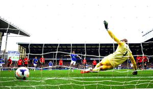 Everton's Leighton Baines scores his side's first goal from the penalty spot during the Barclays Premier League match at Goodison Park, Liverpool.
