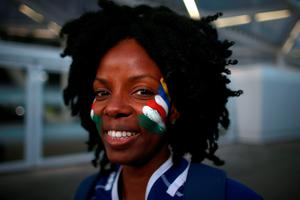 A Namibia fan shows her support outside the ground before the Rugby World Cup match at the Olympic Stadium, London.