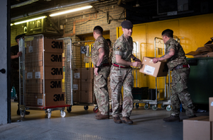 HELPING HANDS: Members of the 101 Logistic Brigade of the British Army deliver a consignment of medical masks to St Thomas' hospital in London.
