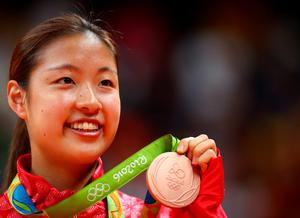 RIO DE JANEIRO, BRAZIL - AUGUST 19:  Bronze medalist Nozomi Okuhara of Japan celebrates during the medal ceremony after the Women's Singles Badminton competition on Day 14 of the Rio 2016 Olympic Games at Riocentro - Pavilion 4 on August 19, 2016 in Rio de Janeiro, Brazil.  (Photo by Clive Brunskill/Getty Images)