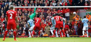 Liverpool's Martin Skrtel scores their second goal during the Barclays Premier League match at Anfield, Liverpool