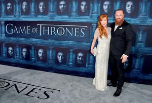 """HOLLYWOOD, CALIFORNIA - APRIL 10:  Actor Kristofer Hivju (R) and Gry Molvær attend the premiere of HBO's """"Game Of Thrones"""" Season 6 at TCL Chinese Theatre on April 10, 2016 in Hollywood, California.  (Photo by Alberto E. Rodriguez/Getty Images)"""