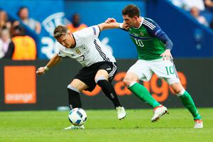 PARIS, FRANCE - JUNE 21: Bastian Schweinsteiger of Germany and Kyle Lafferty of Northern Ireland compete for the ball during the UEFA EURO 2016 Group C match between Northern Ireland and Germany at Parc des Princes on June 21, 2016 in Paris, France.  (Photo by Clive Mason/Getty Images)