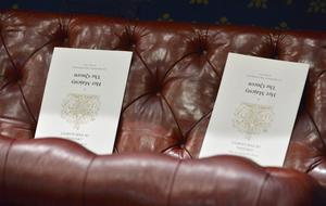 LONDON, ENGLAND - MAY 08: Order of service cards sit on seats in the House of Lords ahead of the State Opening of Parliament on May 8, 2013 in London, England. Queen Elizabeth II will unveil the coalition government's legislative programme in a speech delivered to Members of Parliament and Peers in The House of Lords today. Proposed legislation is expected to be introduced on toughening immigration regulations, capping social care costs in England and setting a single state pension rate of 144 GBP per week.  (Photo by Toby Melville - WPA Pool/Getty Images)