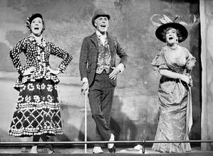 Julie Andrews, Bruce Forsyth and Beryl Reid (right), singing 'Piccadilly,' on stage at the old Brixton Music Hall. PA Wire