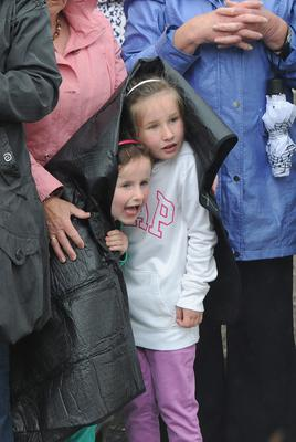 1/6/2013. Wellwishers young and old take cover at the wedding of Helen McConnell to Manchester United and Northern Ireland football star Jonny Evans at Clough Presbyterian Church in County Antrim this afternoon. Picture Charles McQuillan/Pacemaker.