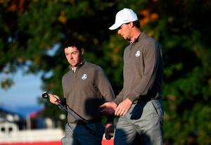 CHASKA, MN - OCTOBER 01:  Rory McIlroy and Thomas Pieters of Europe react on the second green during morning foursome matches of the 2016 Ryder Cup at Hazeltine National Golf Club on October 1, 2016 in Chaska, Minnesota.  (Photo by Ross Kinnaird/Getty Images)