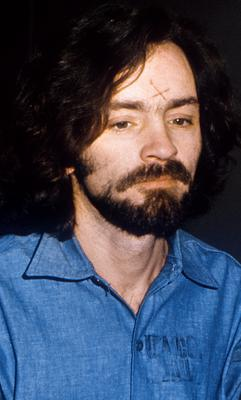 Charles Manson in court with his carved forehead