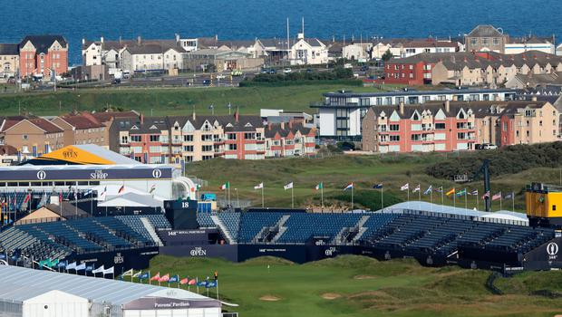A general view of 18th Green in front of the grandstand and the town of Portrush during preview day one of The Open Championship 2019 at Royal Portrush Golf Club. PRESS ASSOCIATION Photo. Picture date: Sunday July 14, 2019. See PA story GOLF Open. Photo credit should read: Niall Carson/PA Wire. RESTRICTIONS: Editorial use only. No commercial use. Still image use only. The Open Championship logo and clear link to The Open website (TheOpen.com) to be included on website publishing.