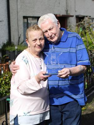Spirit NI award winners Alistair and Pearl Brown with their award at their home in Warrenpoint. Pic by Peter Morrison