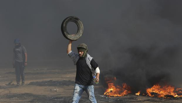 A Palestinian protester near the Gaza Strip's border with Israel, during a protest on the first Friday of the holy month of Ramadan (Adel Hana/AP)
