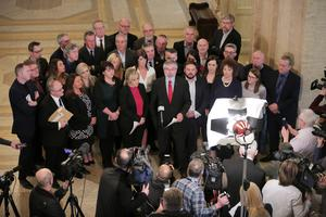 Sinn Fein leaders Gerry Adams and Michelle O'Neill join other newly elected Sinn Fein MLAs during a press conference at Parliament Buildings, Stormont. Photo by Kelvin Boyes / Press Eye
