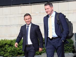Former boxing world champion, Carl Frampton arrives at Belfast High court this morning with his legal counsel, John Finucane for the second day of his legal battle with his former manager, Barry McGuigan. Picture Stephen Davison