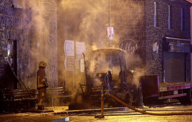 ATM ripped from the wall of a building in the town centre of Bushmills. A tractor was left burnt out at the scene. Pic Steven McAuley/McAuley Multimedia