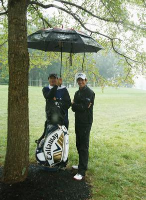 LOUISVILLE, KY - AUGUST 08:  Matteo Manassero of Italy waits with his caddie Alberto Binaghi on the tenth hole during the weather-delayed second round of the 96th PGA Championship at Valhalla Golf Club on August 8, 2014 in Louisville, Kentucky.  (Photo by Warren Little/Getty Images)