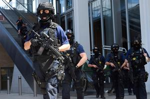 Armed police officers patrol outside The Shard tower and London Bridge railway station in London on June 4, 2017, as police continue their investigations following the June 3 terror attack. Seven people were killed in a terror attack on Saturday by three assailants on London Bridge and in the bustling Borough Market nightlife district, the chief of London's police force said on Sunday. / AFP PHOTO / NIKLAS HALLE'NNIKLAS HALLE'N/AFP/Getty Images