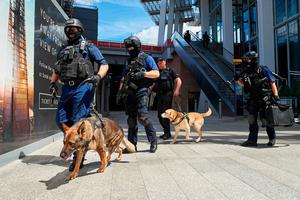 Armed police officers with police dogs patrol outside The Shard tower and London Bridge railway station in London on June 4, 2017, as police continue their investigations following the June 3 terror attack. Seven people were killed in a terror attack on Saturday by three assailants on London Bridge and in the bustling Borough Market nightlife district, the chief of London's police force said on Sunday. / AFP PHOTO / NIKLAS HALLE'NNIKLAS HALLE'N/AFP/Getty Images