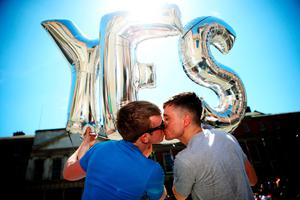 Paul Bonass (left) and Luke Hoare Greene share a kiss at the Central Count Centre in Dublin Castle, Dublin as votes are continued to be counted in the referendum on same-sex marriage.  PRESS ASSOCIATION Photo. Picture date: Saturday May 23, 2015. See PA story IRISH GayMarriage. Photo credit should read: Brian Lawless/PA Wire
