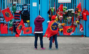 Munster Rugby fans place tributes outside Thomond Park in Limerick after the death of head coach Anthony Foley. Niall Carson/PA Wire