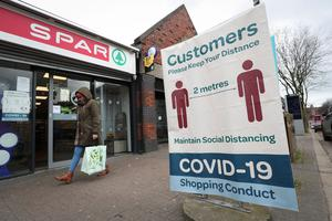 A Covid-19 customer sign in Botanic Avenue, Belfast, Northern Ireland requesting customers keep their distance on Monday March 30th. Photo by Kelvin Boyes / Press Eye.