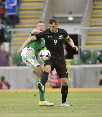 Press Eye - Belfast - Northern Ireland 2nd  June  2017 - Picture by Stephen Hamilton / Press Eye. Friendly International match between Northern Ireland and New Zealand at the National Stadium in Belfast.  Northern Irelands Johnny Evans in action with New Zealands Chris Wood