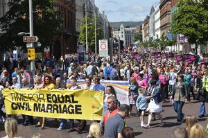 """Pacemaker press 13/6/15 Thousands of people have attended a march in Belfast, calling for the introduction of civil marriage for same-sex couples in Northern Ireland. The march began at Writer's Square and moved towards Belfast City Hall, where a rally was  held.The organisers said Northern Ireland is """"out on a limb"""" as the only part of the UK and Ireland not to change its laws. The Northern Ireland Assembly has debated the issue four times, and each time MLAs rejected same-sex marriage. Picture Mark marlow/pacemaker press"""