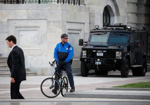 WASHINGTON, DC - NOVEMBER 17: A US Capitol Police Officer stands guard in front of the US Capitol, November 17, 2015 in Washington, DC. The Islamic State recently released a video this morning threatening additional attacks in the nation's capital following Friday's attacks in Paris, though over the weekend an F.B.I. spokesman issued a release saying, At this time, there is no specific or credible threat to the United States.  (Photo by Mark Wilson/Getty Images)