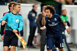 WOLFSBURG, GERMANY - APRIL 06: Marcelo of Real Madrid appeals to an assistant referee during the UEFA Champions League Quarter Final First Leg match between VfL Wolfsburg and Real Madrid at Volkswagen Arena on April 6, 2016 in Wolfsburg, Germany.  (Photo by Stuart Franklin/Bongarts/Getty Images)