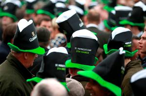 Racegoers wear Guinness Hats on St Patrick's Day during the Cheltenham Festival at Cheltenham Racecourse. PRESS ASSOCIATION Photo. Picture date: Thursday March 12, 2015. See PA story RACING Cheltenham. Picture credit should read: David Davies/PA Wire. RESTRICTIONS: Editorial Use only, commercial use is subject to prior permission from The Jockey Club/Cheltenham Racecourse. Call +44 (0)1158 447447 for further information.