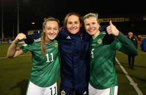 Press Eye - Belfast, Northern Ireland - 27th November 2020 - Photo by William Cherry/Presseye  Northern Ireland's Lauren Wade, Sarah McFadden and Julie Nelson celebrate at the final whistle after defeating Belarus during Friday nights Women's Euro 2021 Qualifier at Seaview, Belfast.    Photo by William Cherry/Presseye