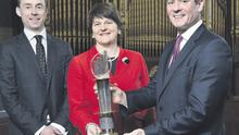 Partner-in-charge of EY Entrepreneur Of The Year Frank O'Keeffe, Enterprise Minister Foster MLA, and EY tax partner Rob Heron at the launch of the EY Entrepreneur Of The Year 2014 programme held at the Ulster Hall
