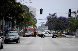 SANTA MONICA, CA - JUNE 07:  Fire trucks and police vehicles arrive on scene after multiple shootings were reported on the campus of Santa Monica College June 7, 2013 in Santa Monica, California.  According to reports, at least one person has died, four people hospitalized, and a suspect was taken into custody. (Photo by Kevork Djansezian/Getty Images)